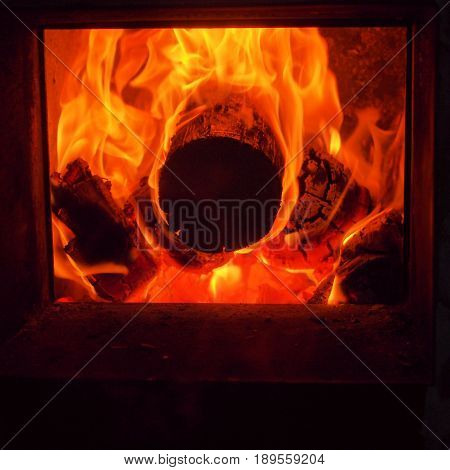 The flames in the firebox. Burning firewood. The firebox of the furnace. Bath.