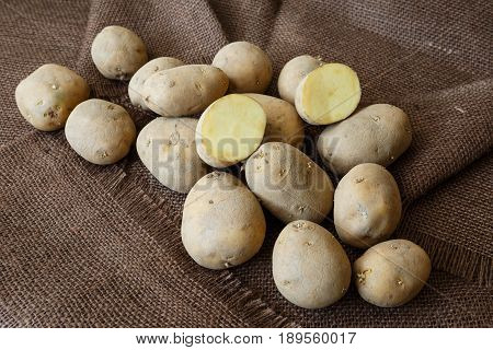 Old Potato With Young Sprouts On A Wooden Table Ready For Planting