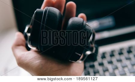 Wireless Headphones In The Male Hands Of A European Man Close-up. New Technologies In Listening To M