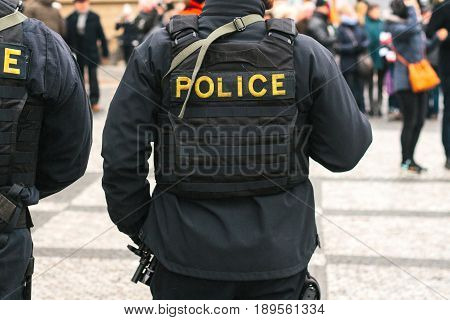 A policeman on the protection of public order. A conceptual image of protecting people by the police.