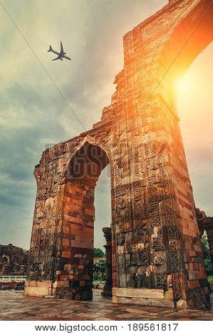 Airplane in sky above Qutb Minar Complex