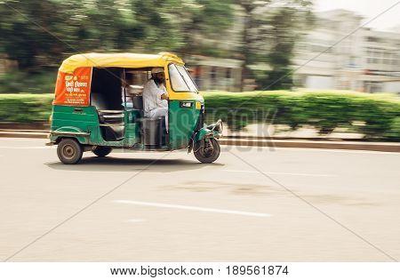 New Delhi, India - AUGUST 13: Moto-Rickshaw in motion, New Delhi, India on AUGUST 13, 2016 in New Delhi, India.