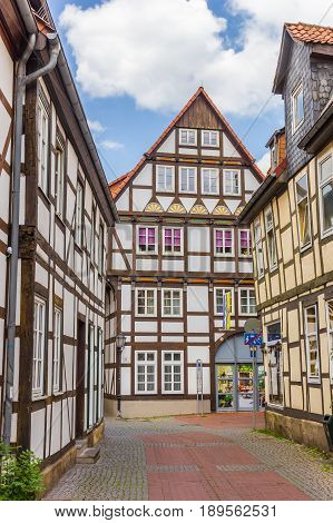 HAMELN, GERMANY - MAY 22, 2017: Cobblestoned street with half-timbered houses in Hameln, Germany