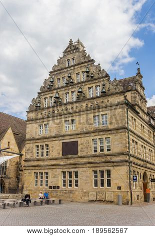 HAMELN, GERMANY - MAY 22, 2017: Historic house Hochzeitshaus at the central market square of Hameln, Germany