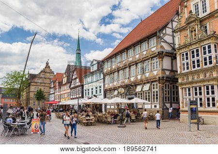 HAMELN, GERMANY - MAY 22, 2017: Cobblestoned street with historic houses, cafes and restaurants in Hameln, Germany