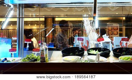 Salad bar in Sizzler at Central West Gate Plaza branch Nonthaburi province Thailand time 06:37 pm. 2017 June 4 Macro photo focus select at bar Out side has people waiting in que is blur.