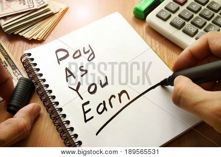 Pay As You Earn - PAYE written in a note.