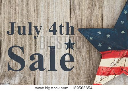 4th of July savings message USA patriotic old star on a weathered wood background with text July 4th Sale