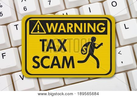 Tax scam warning sign A yellow warning sign with text Tax Scam and theft icon on a keyboard 3D Illustration