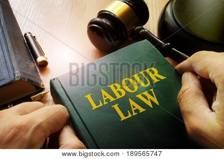 Labour law on an office table and gavel.