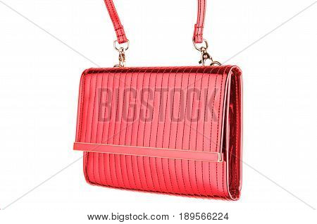 Woman's evening fashionable stitched red clutch with golden details made of smooth shining patent leather isolated on white background. Logos removed.