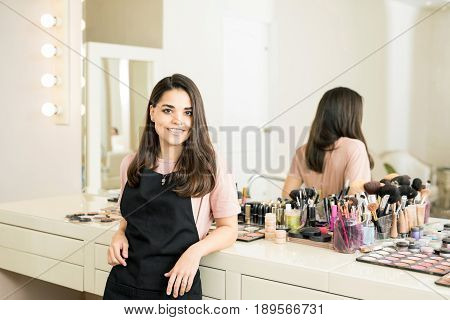 Cute Hispanic Makeup Artist In Her Salon