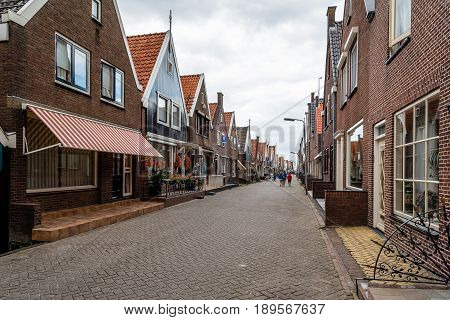 Veolendam Netherlands - August 08 2016. Main street of Volendam. Volendam is a popular tourist attraction in the Netherlands well known for its old fishing boats and the traditional clothing still worn by some residents