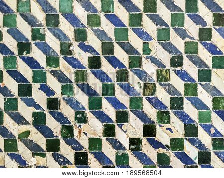 A eries of blue green and white tiles are laid out on a repeating pattern on a section of wall in Sintra Portugal.
