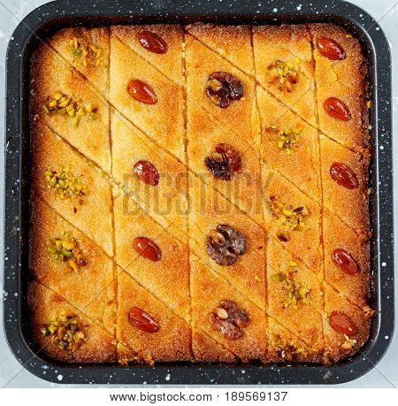 Arab traditional bass with different nuts. Eastern dessert from semolina.