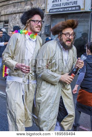 JERUSALEM - MARCH 13 : Ultra Orthodox drunk man during Purim in Mea Shearim Jerusalem on March 13 2017 Purim is a Jewish holiday celebrates the salvation of the jews from genocide in ancient Persia