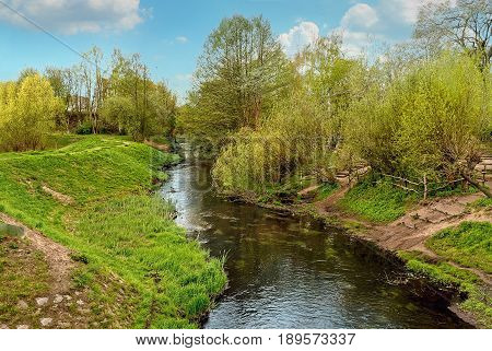 Panke river, a right tributary of the Spree, in Pankow, Berlin, Germany in the springtime.
