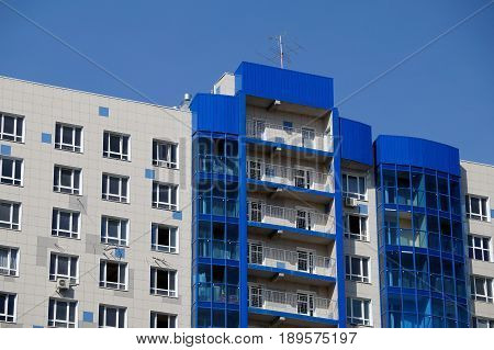 New house revetted with a multi-colored granite tile in the city of Volgograd