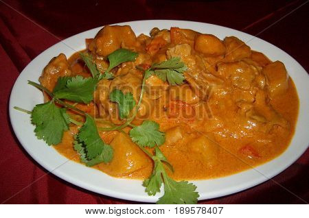 Chicken curry A plate of chicken curry with herbs on top
