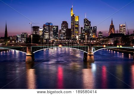 Frankfurt am Main, Hessen, Germany - April 6, 2017: Frankfurt am Main city skyline during blue hour in Frankfurt, Germany