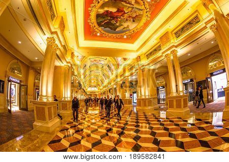 Macau, China - December 8, 2016: The Venetian Luxury Resort and Casino interior. Elegant, majestic and golden corridor with colonnades. The Venetian is an enlarged replica of the one in Las Vegas.
