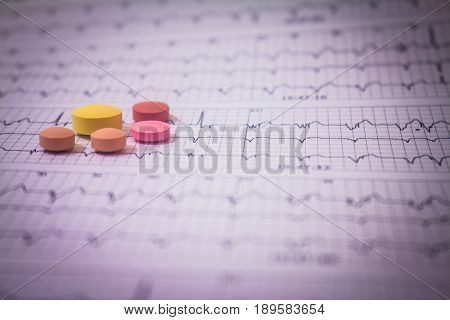 Holter electrocardiogram trace of a patient with pacemakers and some colored pills