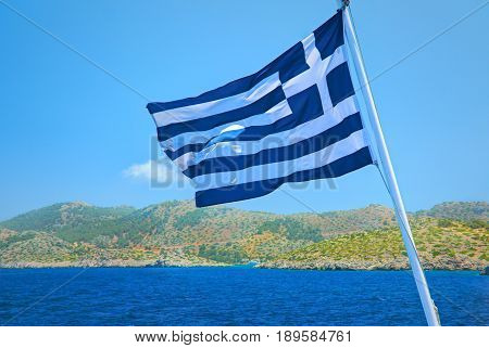 Greece flag consists of colors blue and white straps and white cross - symbol of blue sea and white sea scum or sky. Greece national flag. Greek flag. Greece holidays vacations tours