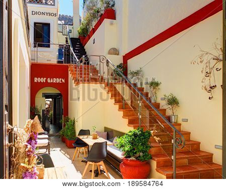 LINDOS, RHODES ISLAND, GREECE, JUN 25, 2015: Classical Greek style design restaurant taverna Dionysos Roof Garden with open stair staircase beautiful interior. Greece island holidays vacation tours