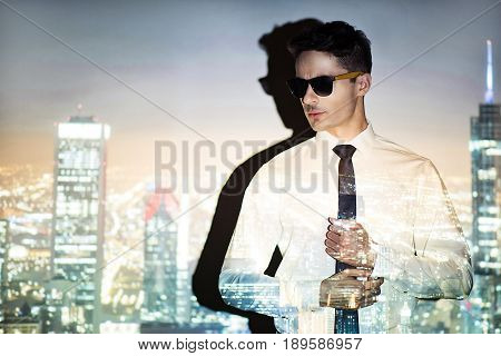Portrait of serene young male locating in big modern metropolis