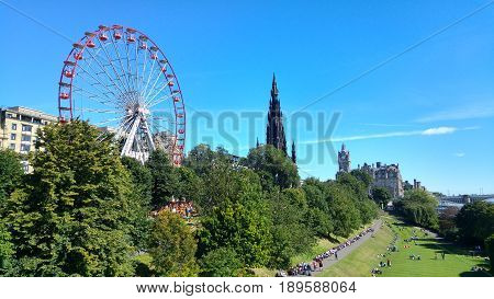 Edinburgh Scotland - August 21 2016: Princes Street Gardens in Edinburgh with unidentified people. It is a public park in the centre of Edinburgh created in two phases in the 1770s and 1820s