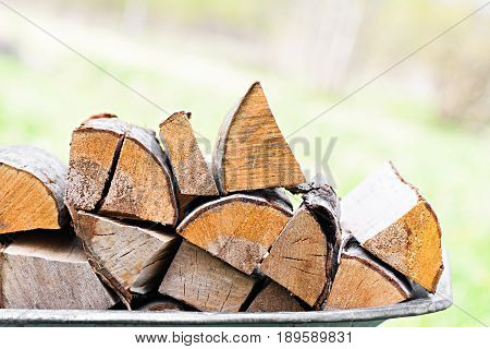 Put together firewood from alder wood and birch background closeup