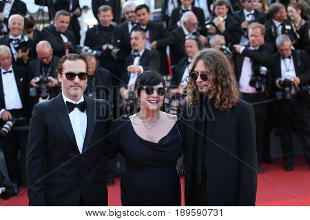 Joaquin Phoenix and director Lynne Ramsay  attend the Closing Ceremony of the 70th annual Cannes Film Festival at Palais des Festivals on May 28, 2017 in Cannes, France.