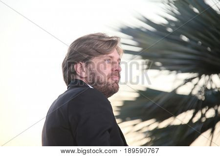 Ruben Ostlund, who won the Palme d'Or for the movie 'The Square attends the Palme D'Or winner photocall during the 70th annual Cannes Film Festival at Palais  on May 28, 2017 in Cannes, France.