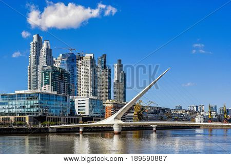 Daytime view at the waterfront in Puerto Madero with the Puente de la Mujer Buenos Aires Argentina.