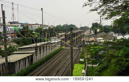 Train station in the middle of houses photo taken in Jakarta Indonesia java