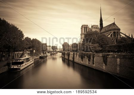 Paris River Seine with Notre-Dame cathedral and boat in France.