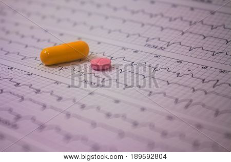 Holter electrocardiogram trace of a patient with pacemaker and some colored pills
