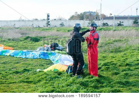 Preparation of tandem paraglider for the first flight.