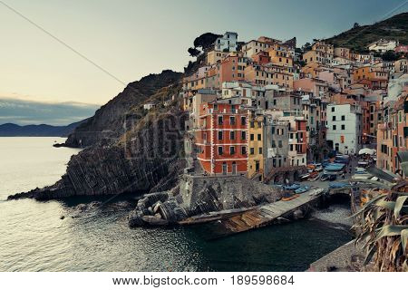 Riomaggiore waterfront view at sunset with buildings in Cinque Terre, Italy.