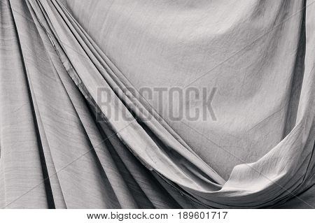 Old fabric drapery background texture. Black & white