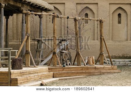 Old gallows in the city plaza. Ancient city