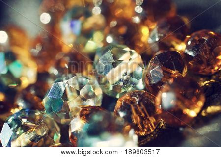 Abstract shiny background with multi-colored glass beads close-up