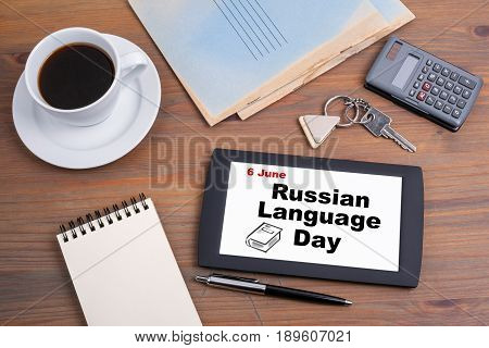 6 June Russian Language Day. Text on tablet device on a wooden table.