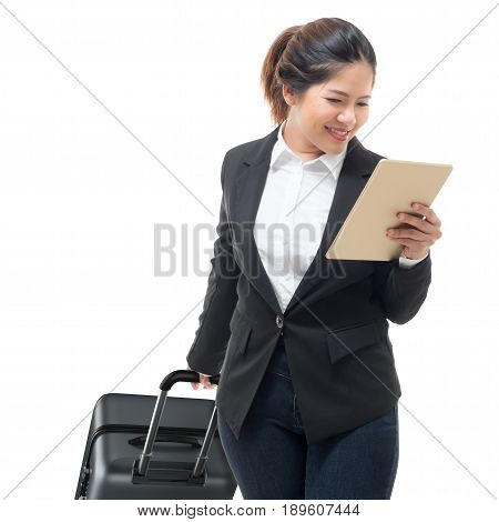businesswoman hand holding tablet while carrying luggage