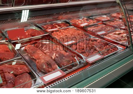 Beef meat in cooled display in food supermarket