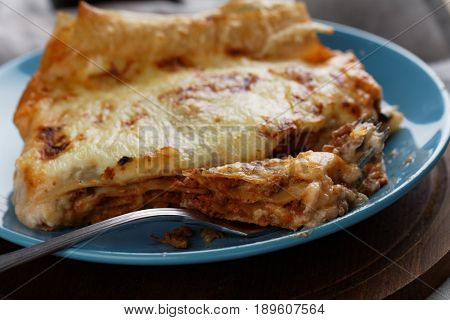 Portion of Lasagna Bolognese on a rustic table