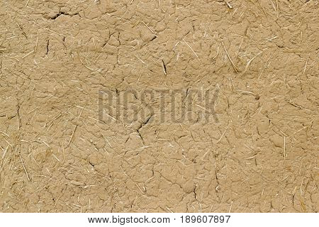 Old Clay Wall Cracked Straw Background