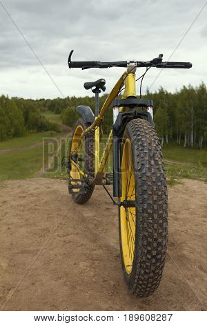 Fat bike - dirty bicycle outdoor, vertical photo