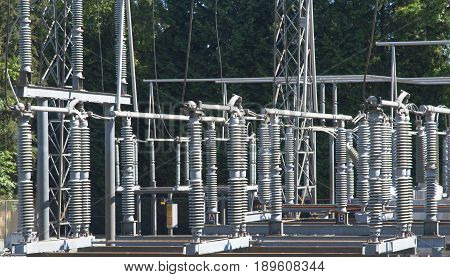 Fragment of Electrical Substation on the background of green trees