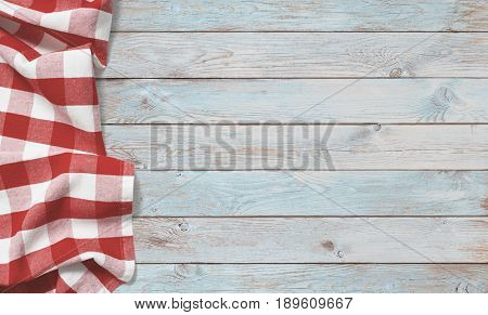 red picnic cloth on blue wood table